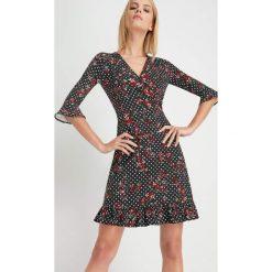 Sukienki: Sukienka z falbankami