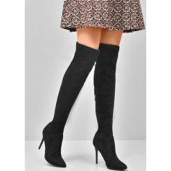 Czarne Kozaki Ohio. Czarne buty zimowe damskie marki Kazar, ze skóry, na wysokim obcasie. Za 94,99 zł.