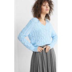 Sweter z warkoczami. Czarne swetry klasyczne damskie marki Orsay, xs, z bawełny, z dekoltem na plecach. Za 99,99 zł.