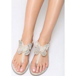 Beżowe Sandały Uniqueness. Brązowe sandały damskie marki Born2be, z materiału, na obcasie. Za 59,99 zł.