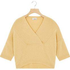 Sweter w kolorze kremowym. Białe swetry oversize damskie Rodier, prążkowane. W wyprzedaży za 169,95 zł.