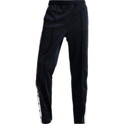 Champion Reverse Weave SPECIAL SEMI DULL Spodnie treningowe navy. Niebieskie spodnie dresowe męskie Champion Reverse Weave, z dresówki. Za 359,00 zł.