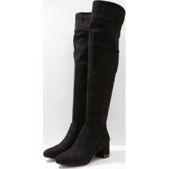 MICHAEL Michael Kors JAMIE MID Muszkieterki black. Czarne buty zimowe damskie marki MICHAEL Michael Kors, z gumy, przed kolano, na wysokim obcasie. W wyprzedaży za 495,60 zł.