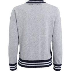 Timberland Bluza rozpinana marine. Czerwone bluzy chłopięce rozpinane marki Timberland, z materiału. Za 269,00 zł.