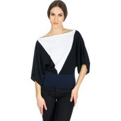 Sweter w kolorze biało-czarnym. Białe swetry oversize damskie Deni Cler, z denimu. W wyprzedaży za 399,95 zł.