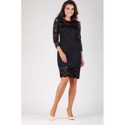 Czarna Wyjściowa Ołówkowa Sukienka z Koronką. Czarne sukienki koktajlowe Molly.pl, l, w koronkowe wzory, z koronki, dopasowane. W wyprzedaży za 102,21 zł.