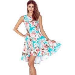 148-1 sukienka z dłuższym tyłem - kwiaty brzoskwiniowe na niebieskim t. Pomarańczowe sukienki na komunię marki numoco, l, w kwiaty, z dekoltem w łódkę, oversize. Za 163,00 zł.