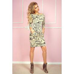 Cher Sukienka sportowa - gazetowe napisy + beżowy. Różowe sukienki sportowe marki numoco, l, z długim rękawem, maxi, oversize. Za 109,00 zł.