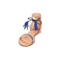 Sandały Betty London  GUSTA. Żółte sandały damskie marki Betty London. Za 159,20 zł.