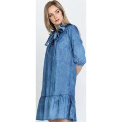 Niebieska Sukienka Friller. Niebieskie sukienki hiszpanki Born2be, z denimu, z falbankami. Za 79,99 zł.
