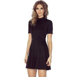 Isabella Sukienka z półgolfem i krótkim rękawkiem - czarna. Sukienki małe czarne marki morimia, s, z krótkim rękawem. Za 149,99 zł.