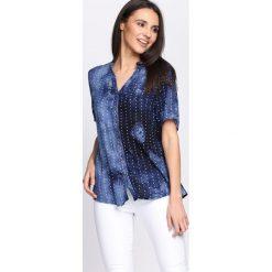 Ciemnoniebieska Koszula Let It Be. Niebieskie koszule damskie marki ARTENGO, z elastanu, ze stójką. Za 39,99 zł.