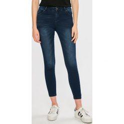 Review - Jeansy Minnie. Niebieskie jeansy damskie rurki marki Review, z bawełny. W wyprzedaży za 49,90 zł.