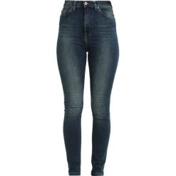 Denim is Dead NAIVE Jeans Skinny Fit mid blue wash. Niebieskie rurki damskie Denim is Dead. Za 389,00 zł.