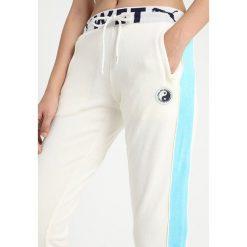 Fenty PUMA by Rihanna FITTED TRACK PANT Spodnie treningowe vanilla ice. Białe bryczesy damskie Fenty PUMA by Rihanna, xs, z bawełny. Za 719,00 zł.