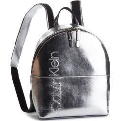 Plecak CALVIN KLEIN - Dual Backpack Metali K60K604659 904. Szare plecaki damskie Calvin Klein, ze skóry ekologicznej, klasyczne. Za 649,00 zł.