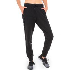 Spodnie dresowe damskie: Asics Spodnie dresowe damskie Jog Asics  czarne r. S (1411400904)