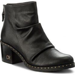 Botki CARINII - B4281/N L23-000-POL-861. Czarne buty zimowe damskie Carinii, ze skóry ekologicznej. W wyprzedaży za 239,00 zł.