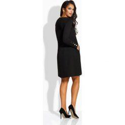 Długie sukienki: Elegancka rozkloszowana sukienka czarna