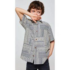 Mango Kids - Koszula dziecięca Glen 110-164 cm. Szare koszule chłopięce z krótkim rękawem Mango Kids, z tkaniny, z klasycznym kołnierzykiem. W wyprzedaży za 49,90 zł.
