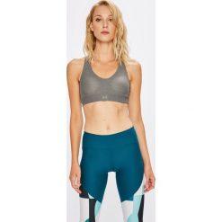 Under Armour - Biustonosz Balance Mid Heather. Brązowe biustonosze sportowe marki Under Armour, z dzianiny. W wyprzedaży za 129,90 zł.