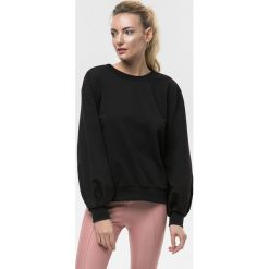 Cardio Bunny - Bluza Bell. Czarne bluzy sportowe damskie marki DOMYOS, z elastanu. W wyprzedaży za 129,90 zł.
