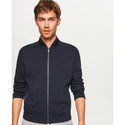 Bluza ze strukturalnej dzianiny - Granatowy. Niebieskie bluzy męskie marki Reserved, l, z dzianiny. W wyprzedaży za 99,99 zł.