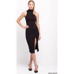 Sukienka z koronką czarna. Niebieskie sukienki koronkowe marki Pakamera. Za 260,00 zł.
