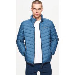 Pikowana kurtka z kontrastową podszewką - Niebieski. Niebieskie kurtki męskie pikowane Cropp, m. Za 129,99 zł.