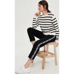 Swetry damskie: Luźny sweter - Biały
