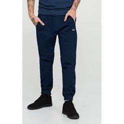 Spodnie dresowe męskie: Spodnie dresowe baggy – Granatowy