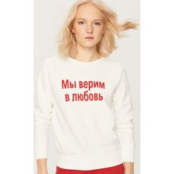 Bluza z nadrukiem - Kremowy. Białe bluzy męskie rozpinane marki Reserved, l, z nadrukiem. Za 79,99 zł.