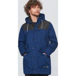 Zimowy płaszcz - Granatowy. Niebieskie płaszcze zimowe męskie marki Cropp, l. W wyprzedaży za 229,99 zł.