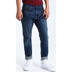 Hollister Co. MEDIUM SLIM STRAIGHT Jeansy Straight Leg medium wash. Niebieskie rurki męskie Hollister Co. Za 209,00 zł.