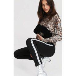 Czarno-Białe Spodnie Dresowe Adult Tree. Szare spodnie dresowe damskie marki New Balance, xs, z dresówki. Za 49,99 zł.