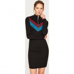Dzianinowa sukienka mini - Czarny. Czarne sukienki dzianinowe marki numoco, l, z długim rękawem, midi, oversize. Za 59,99 zł.