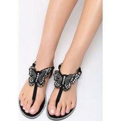 Czarne Sandały Uniqueness. Czarne sandały damskie marki Born2be, z materiału, na obcasie. Za 59,99 zł.