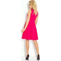 Marina Sukienka z koła - dekolt w kształcie serca - gruba lacosta malinowa. Różowe sukienki marki numoco, l, z długim rękawem, maxi, oversize. Za 159,99 zł.
