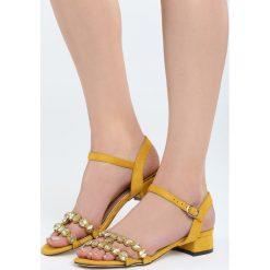Żółte Sandały Inquisitive Nature. Żółte sandały damskie na słupku marki Born2be, z materiału, na wysokim obcasie. Za 69,99 zł.