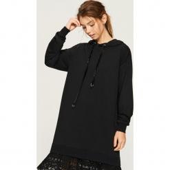 Dzianinowa sukienka z kapturem - Czarny. Czarne sukienki dzianinowe Sinsay, m, z kapturem. Za 79,99 zł.