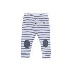 Name it Spodnie Geo bright white. Białe spodnie chłopięce Name it, z bawełny. Za 35,00 zł.