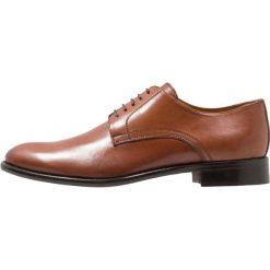 Florsheim RUSSELL Eleganckie buty tan. Brązowe buty wizytowe męskie Florsheim, z materiału, na sznurówki. Za 779,00 zł.