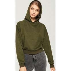 Krótka bluza z kapturem - Khaki. Brązowe bluzy rozpinane damskie Sinsay, l, z krótkim rękawem, krótkie, z kapturem. Za 49,99 zł.