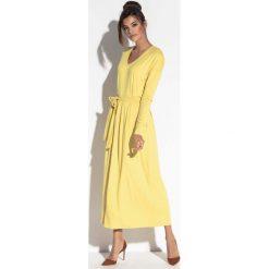 Żółta Długa Sukienka w Serek z Wiązanym Paskiem. Żółte długie sukienki marki Molly.pl, na imprezę, l, eleganckie, dekolt w kształcie v, z długim rękawem, sportowe. Za 179,90 zł.