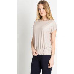 Bluzki damskie: Beżowa bluzka ze ściągaczem u dołu  QUIOSQUE