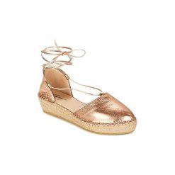 Sandały Betty London  GIORDA. Żółte sandały damskie marki Betty London. Za 231,20 zł.