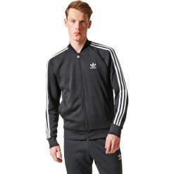 Kurtka Tracktop. Czarne kardigany męskie adidas Originals, m, z bawełny, sportowe. Za 302,36 zł.
