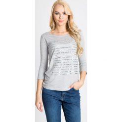 Bluzki asymetryczne: Bluzka z napisem i cekinami QUIOSQUE