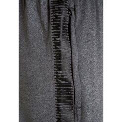 Nike Performance DRY SQAD PANT Spodnie treningowe black/heather. Czarne spodnie dresowe dziewczęce Nike Performance, z elastanu. W wyprzedaży za 149,25 zł.