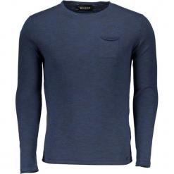 Sweter w kolorze granatowym. Niebieskie swetry klasyczne męskie marki Guess, z materiału. W wyprzedaży za 219,95 zł.